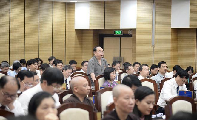 Chất vấn nóng tại HĐND TP.Hà Nội: Đại biểu đề nghị Giám đốc Sở TN&MT đọc lại luật Đất đai - Ảnh 1.