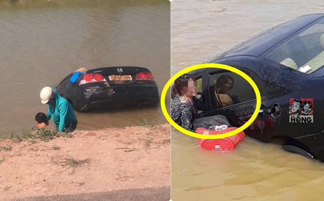 Ô tô lao thẳng xuống sống, người phụ nữ chật vật chui ra từ cửa ghế lái thoát nạn