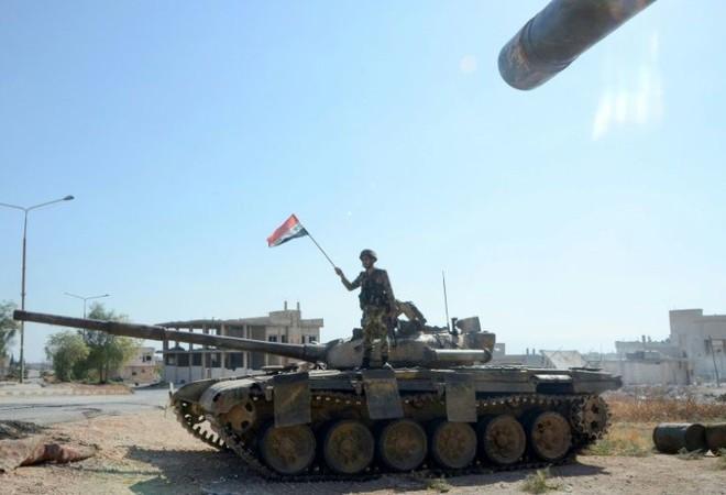 Chùm ảnh quân Assad đánh cho kẻ thù thua tan tác ở chiến trường khốc liệt Syria - Ảnh 1.