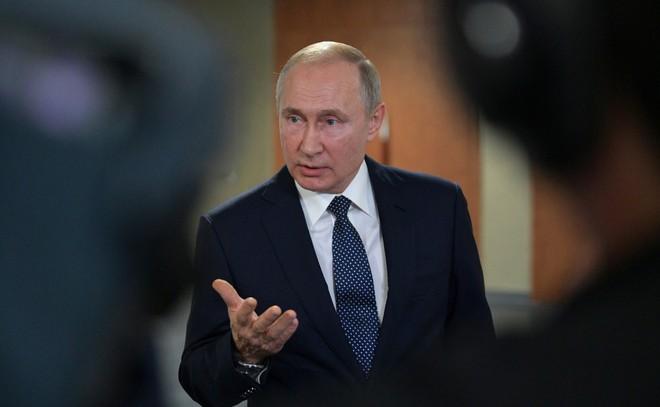 Ông Putin thay đổi thế nào trong 20 năm cầm quyền? - ảnh 20
