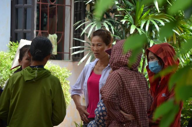 Hiện trường vụ anh truy sát gia đình em ruột khiến 5 người thương vong ở Hà Nội - Ảnh 7.