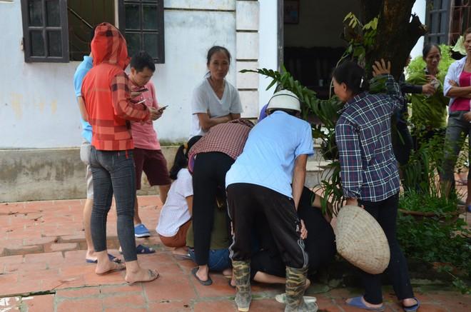 Hiện trường vụ anh truy sát gia đình em ruột khiến 5 người thương vong ở Hà Nội - Ảnh 6.
