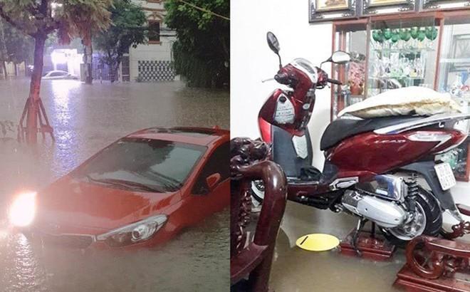 Thái Nguyên 'thất thủ': Nhiều ô tô 'ngụp lặn' trong biển nước, xe máy gác hết lên ghế cho ráo