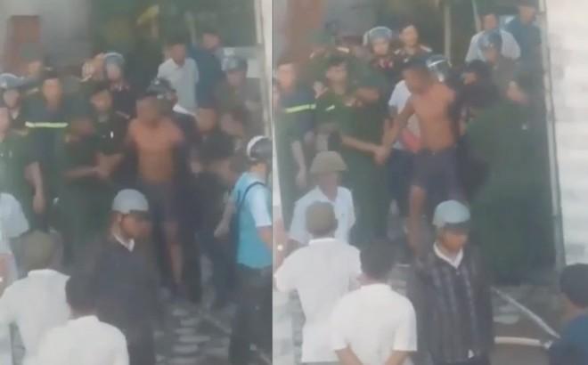Nam thanh niên ôm bình gas cố thủ, xả gas ra đe dọa công an