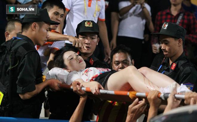 """Người bắn pháo sáng khiến nữ CĐV bị thương ở SVĐ Hàng Đẫy có dấu hiệu phạm tội """"cố ý gây thương tích""""?"""