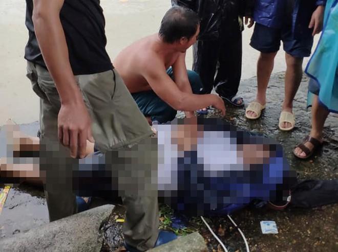 Đi xe máy ngã xuống kênh, một công an viên bị nước cuốn trôi ra hồ tử vong - Ảnh 2.