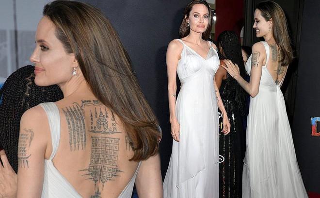 Angelina Jolie diện đầm gợi cảm, lộ hình xăm kín lưng cùng các con đi sự kiện