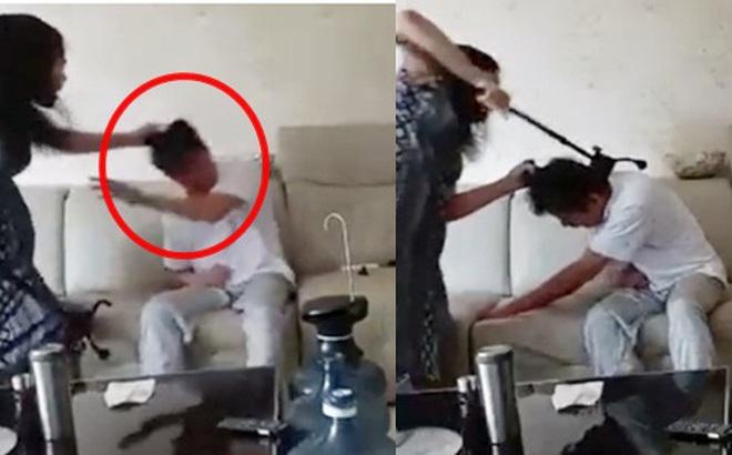 Đoạn clip vợ túm tóc, dùng gậy đánh chồng tới tấp trong khi nạn nhân kêu rên đau đớn gây xôn xao cộng đồng mạng
