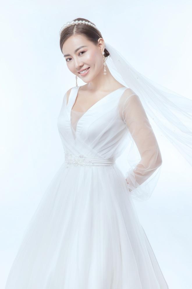 Diễn viên Thanh Hương xinh đẹp lộng lẫy trong lần thứ 2 mặc váy cưới - Ảnh 1.