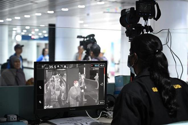 TổngGiám đốc WHO tới Trung Quốc thảo luận kiểm soát dịch, nhiều quốc gia chuẩn bị sơ tán công dân - Ảnh 5.