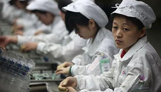 Foxconn thưởng nóng cho nhân viên chịu quay trở lại nhà máy để ráp iPhone - Ảnh 1.