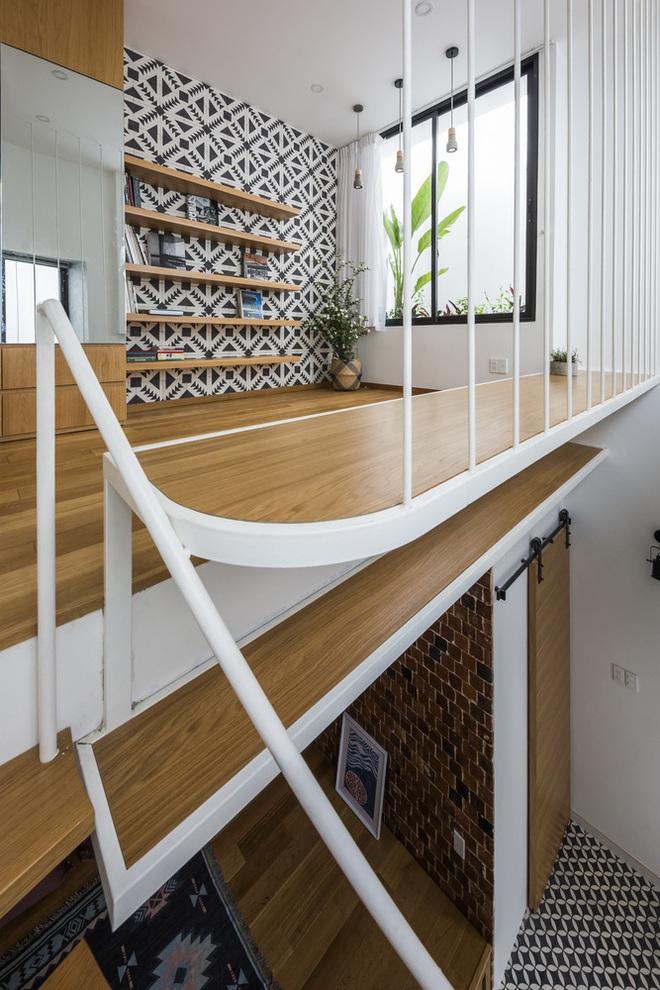 Mãn nhãn với ngôi nhà màu trắng, có lối thiết kế độc đáo tại Tp.HCM - Ảnh 4.