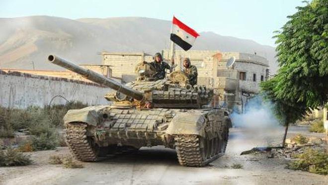 Phiến quân đánh rát, lính Syria bỏ cả chiến tăng T-72 để tháo chạy - Ảnh 11.