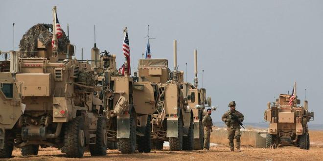 Xe bọc thép Nga húc thẳng thiết giáp Mỹ khi bị cản đường? - Ảnh 4.