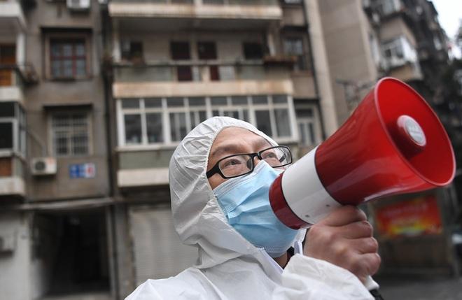 Dùng trạng thái thời chiến: Siết chặt giám sát chưa từng thấy, TQ quyết không để lọt virus corona - Ảnh 2.