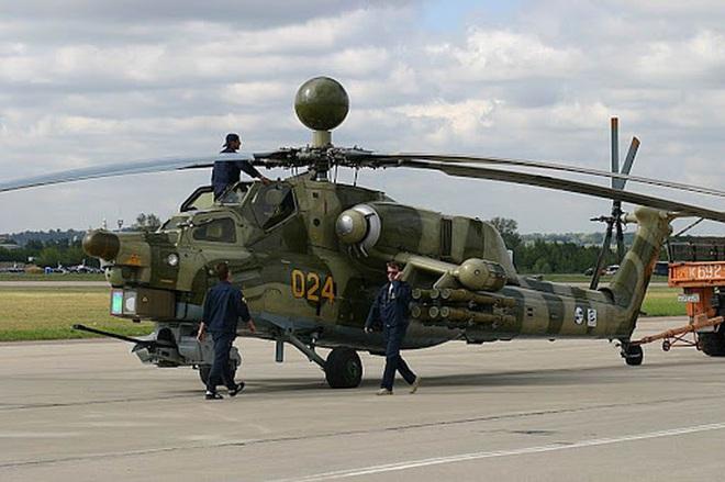 Khẩu pháo 30mm trên Mi-28 xé nát xe bọc thép phiến quân Syria - Ảnh 4.