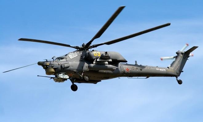 Khẩu pháo 30mm trên Mi-28 xé nát xe bọc thép phiến quân Syria - Ảnh 8.