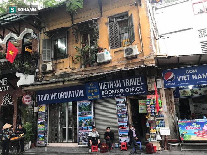 """""""Căng mình"""" chống đỡ Covid-19 không thành, hàng loạt văn phòng tour ở Hà Nội đóng cửa - Ảnh 7."""