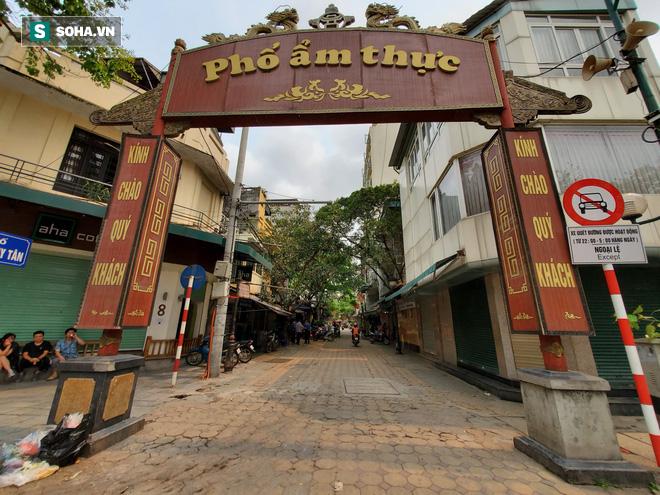 Trung tâm Hà Nội vắng lặng khi hàng loạt quán cà phê, hàng ăn đồng loạt đóng cửa - Ảnh 5.