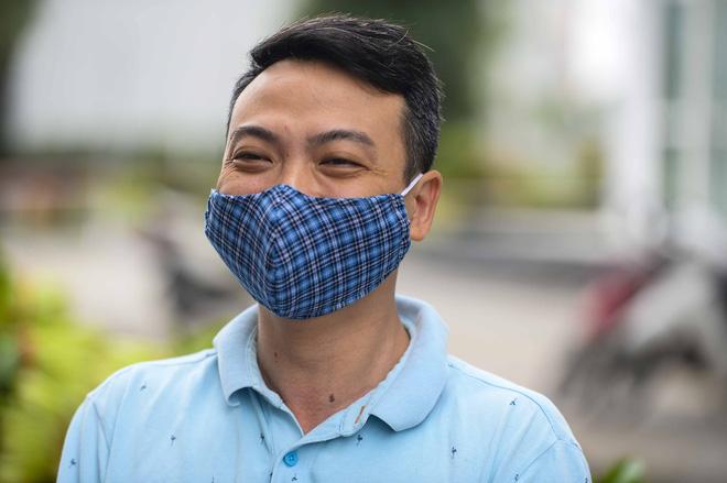 [Ảnh] Tiếp tế 350kg rau cho khu chung cư gần 1000 dân bị cách ly do có người mắc Covid-19 - Ảnh 11.
