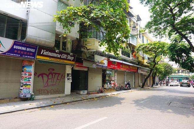 Một tuần sau khi hết cách ly, cả dãy phố ở Hà Nội vẫn không buồn mở cửa - Ảnh 9.