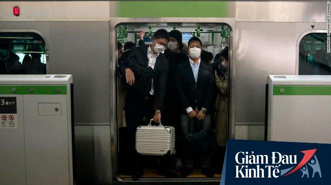 Có thừa công nghệ làm việc ở nhà, tại sao người Nhật đổ xô đến công sở bằng được bất chấp COVID-19? - Ảnh 1.