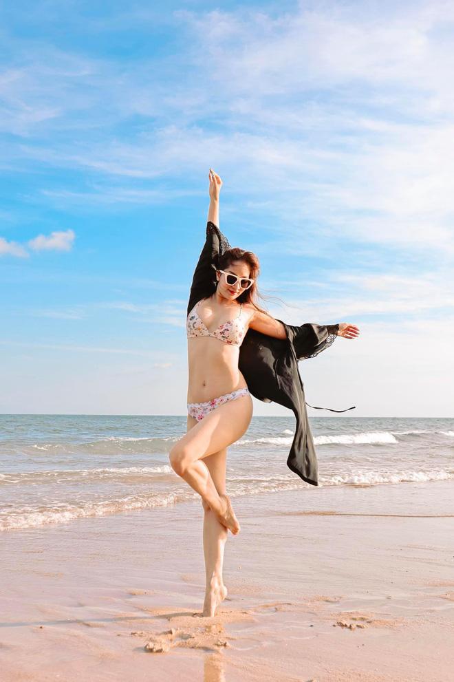 Khánh Thi khoe thân hình gợi cảm với bikini, hôn đắm đuối chồng kém 12 tuổi - Ảnh 4.
