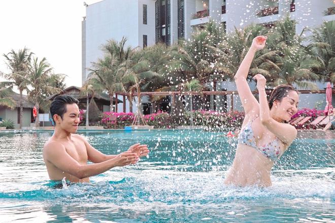 Khánh Thi khoe thân hình gợi cảm với bikini, hôn đắm đuối chồng kém 12 tuổi - Ảnh 7.