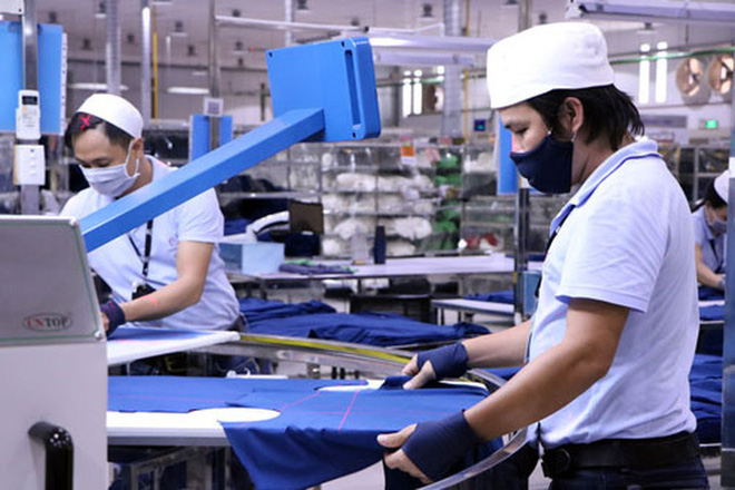 Giữ việc làm cho người lao động - Ảnh 1.