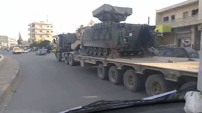 Căng thẳng với Iran và Li-băng lên đỉnh điểm, Israel phóng thử tên lửa đạn đạo - Quân đội Syria vây chặt, buộc đoàn xe Mỹ  tháo lui - Ảnh 1.