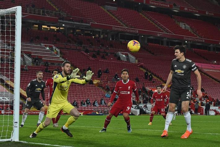 Chấm điểm cầu thủ MU: Luke Shaw, Wan-Bissaka bỏ Salah, Mane vào túi quần - Ảnh 1.