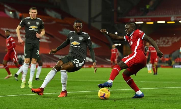 Chấm điểm cầu thủ MU: Luke Shaw, Wan-Bissaka bỏ Salah, Mane vào túi quần - Ảnh 2.