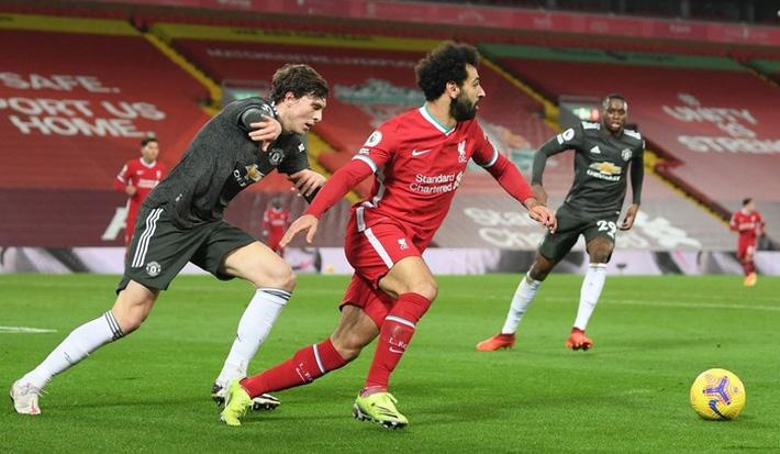 Chấm điểm cầu thủ MU: Luke Shaw, Wan-Bissaka bỏ Salah, Mane vào túi quần - Ảnh 3.