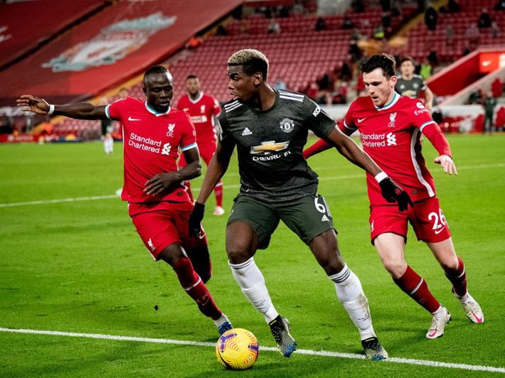 Chấm điểm cầu thủ MU: Luke Shaw, Wan-Bissaka bỏ Salah, Mane vào túi quần - Ảnh 8.