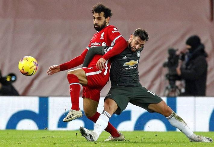 Chấm điểm cầu thủ MU: Luke Shaw, Wan-Bissaka bỏ Salah, Mane vào túi quần - Ảnh 9.