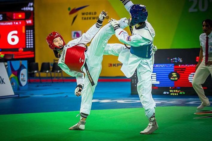 Cô gái Việt khiến võ sĩ Thái Lan ôm hận & lần gây sốc ở giải Vô địch Thế giới - Ảnh 3.