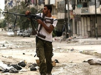 Mỹ hối thúc TQ đóng vai trò tích cực về vấn đề Syria