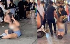 Người phụ nữ khóc lóc, lột đồ trước cửa quán bar 1900 sau khi bị nhân viên đưa ra ngoài: 'Trả chị 110k rồi chị đi về'