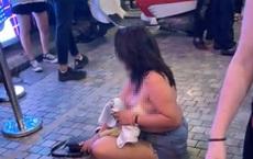 Nguyên nhân người phụ nữ lột đồ, nằm lăn lộn giữa phố Tạ Hiện