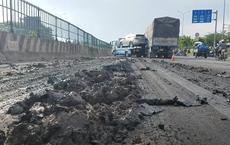 Truy tìm phương tiện làm rơi hàng tấn bùn xuống đường, khiến xế sang 4 tỷ 'trọng thương'