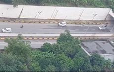 """Ô tô 7 chỗ đi lùi trên Đại lộ Thăng Long: Đoạn clip """"bóc trần"""" sự khôn lỏi của tài xế"""