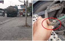 Container bị xì lốp, cắt dây điện vì tài xế đỗ trước cửa quán cơm nhưng lại đi ăn phở