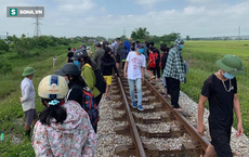 Nghệ An: Mẹ ôm con lên đường ray khi tàu sắp đến, người dân hô hoán thì bỏ chạy, cháu bé tử vong bất thường