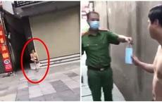 Chăm chỉ đi đổ rác giúp vợ ngày Hà Nội giãn cách, người đàn ông bị công an đưa về phường