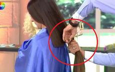 Bất ngờ bị cắt phăng 30cm tóc, người phụ nữ ngất xỉu ngay trên sóng truyền hình