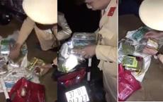 Chạy xe máy chở theo bì tải ma túy còn mang 2 chai xăng để phi tang