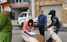 Hà Nội: 2 người đi câu cá, 1 đi bán hoa không thuộc diện được phép ra đường bị phạt 200.000 đồng/người