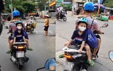 Bố chở con đi chơi, vị trí ngồi của 2 đứa nhỏ khiến cả phố nhìn chằm chằm lo sợ