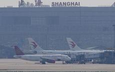 Trung Quốc xuống nước, Mỹ nới lỏng lệnh cấm bay