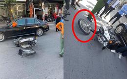 Va chạm với Mercedes tiền tỷ, nam sinh ngã ra đường, bánh xe máy gãy rời ra